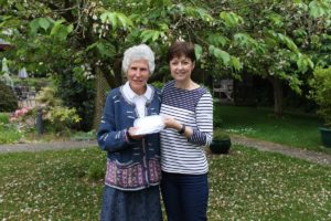 Liz Searle handing over sponsorship money to Sarah Smith