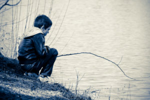 vintage picture of a fishing boy