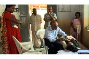 Dr-M-R-Rajagopal-Treating-Patient_Kerala-India