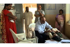 Dr-M-R-Rajagopal-Treating-Patient_Kerala-India.-Image-Moonshine-Agency