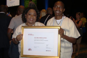 Dr-Zippora-Ali-and-David-Musyoki-from-KEHPCA-display-the-Red-Ribbon-Award-Certificate