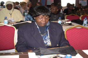 Dr.-Brigid-Sirengo-Board-Chair-KEHPCA-admires-a-bag-issued-at-the-conference