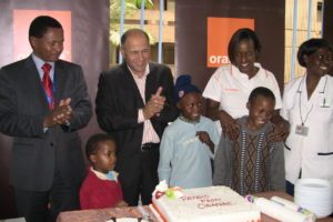 Orange-CEO-KNH-Programmes-officer-clap-during-the-cutting-of-the-cake