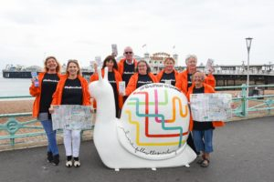 Martlets #bemoresnail art trail campaign with volunteers by Brighton Palace Pier  Photograph taken by Simon Dack / Vervate