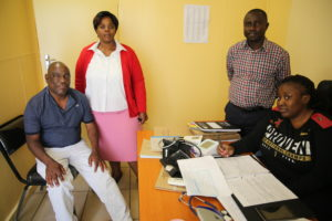 RFM's Sr Sindisiwe  Dlamini, Dr Kombe Makadi Joel, staff Nurse Anna Ngoma Shongwe with a client who has come to refill his morphine