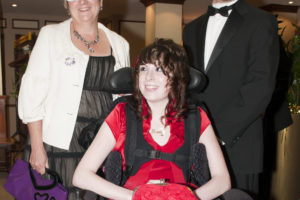 Amy-Claire wth her parents on prom night