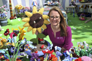 The Work of Heart knitted garden in aid of Sue Ryder, Leckhampton Court Hospice is unveiled at RHS Malvern Show.  Clare Young wanted to create the garden in memory of husband Ken who died at Sue Ryder and to raise money for the charity  picture by Mikal Ludlow Photography  10-5-18 tel; 07855177205