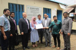 Handover of cheque from Canadian High Commission staff to support the work of the project in Korail