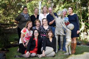 Staff, volunteers and parents appreciate the bronze statue in the new garden
