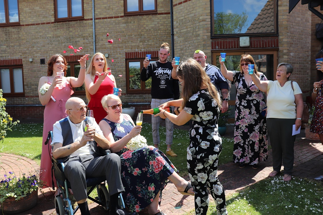 Couple review wedding vows at hospice