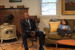 Rep. Cummings at a fireside chat at the home of NHPCO's President and CEO Edo Banach, whose son is pictured at the Congressman's side.