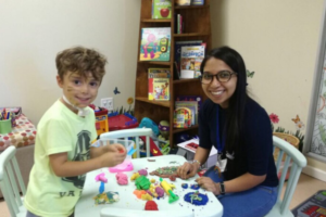 Volunteering at the Paediatric Palliative Care Clinic in Cape Town, South Africa (Paedspal).  Photo published with parental permission.