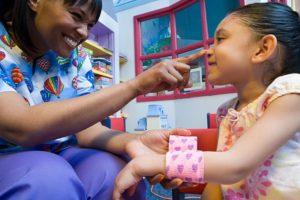 Nurse caring for girl