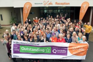 Staff and volunteers at St Giles Hospice celebrate an Outstanding rating 1