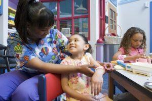Nurse bandaging girls arm