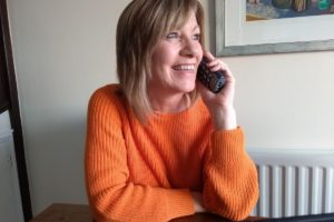 Photo 1 Compassionate Neighbour volunteer Carolyn offers support to local individuals via the telephone