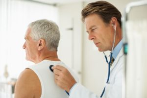doctor-using-stethoscope-to-listen-to-sounds-of-man-breathing