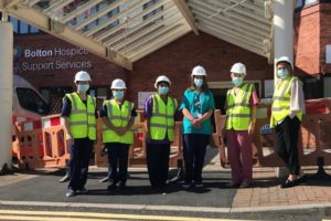 Bolton Hospice staff outside the Wellbeing Hub site