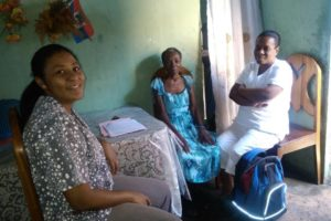 Dr Roche visiting a patient at home with Nurse Desir