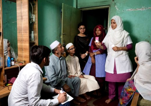 At home care service Senior Staff Nurse Arifa Anjum and Field Coordinator Md. Saiful Hoque briefing about patient's medicine to her family and PCA Mousomi Akter and Volunteer Khusbu listening them