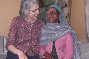 Sue Mumford with a patient in Ethiopia