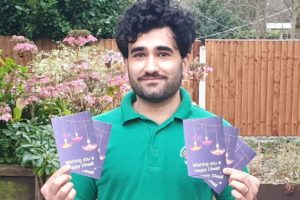 John Taylor Hospice clinical pharmacist Tarun Nayyar with hospice Diwali cards
