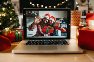 Video call on a laptop screen during Christmas. Celebrating Christmas holidays during Coronavirus Covid-19 pandemic