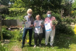 Peggy, Ann, Betty, Volunteers with Certificates
