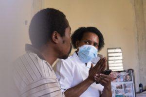 Highway Hospice nurse Sizakele Mlambo speaks to patient Siyabonga Sibiya at his home in Inanda, north of Durban, in KwaZulu-Natal.